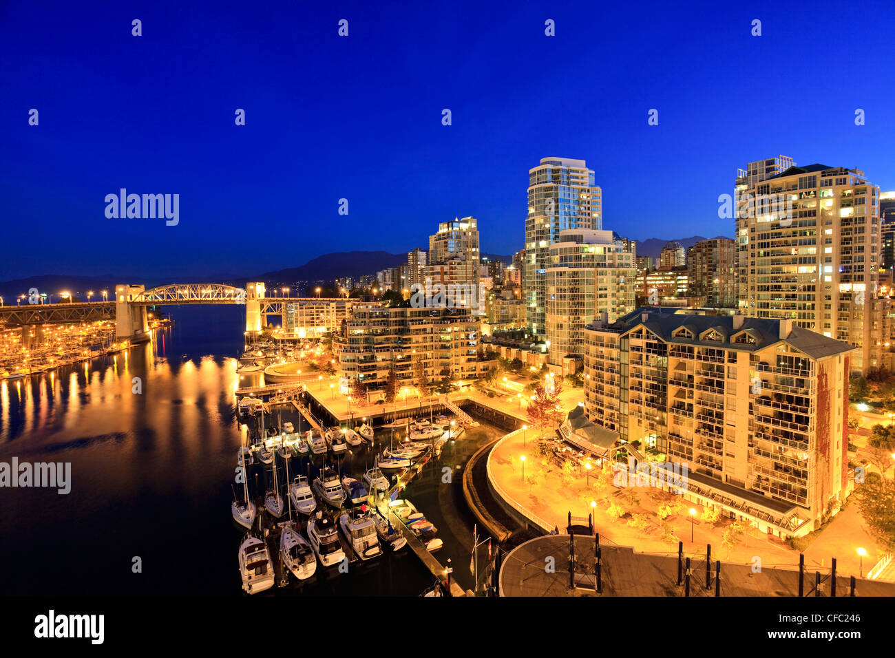 The West End neighbourhood of Vancouver and the Burrard Street Bridge across False creek, Vancouver British Columbia - Stock Image
