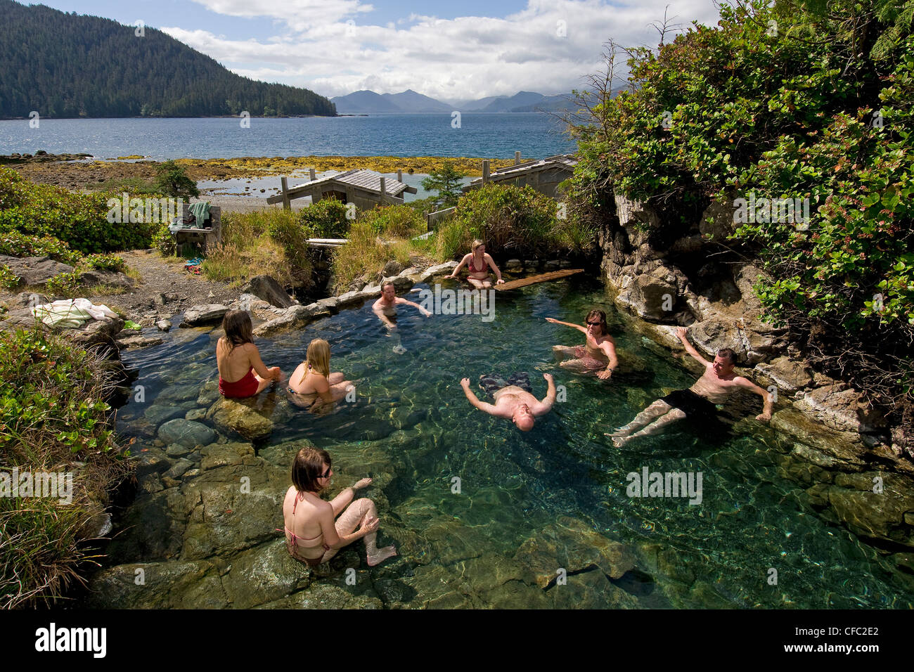 group young people enjoy natural hot-springs Stock Photo