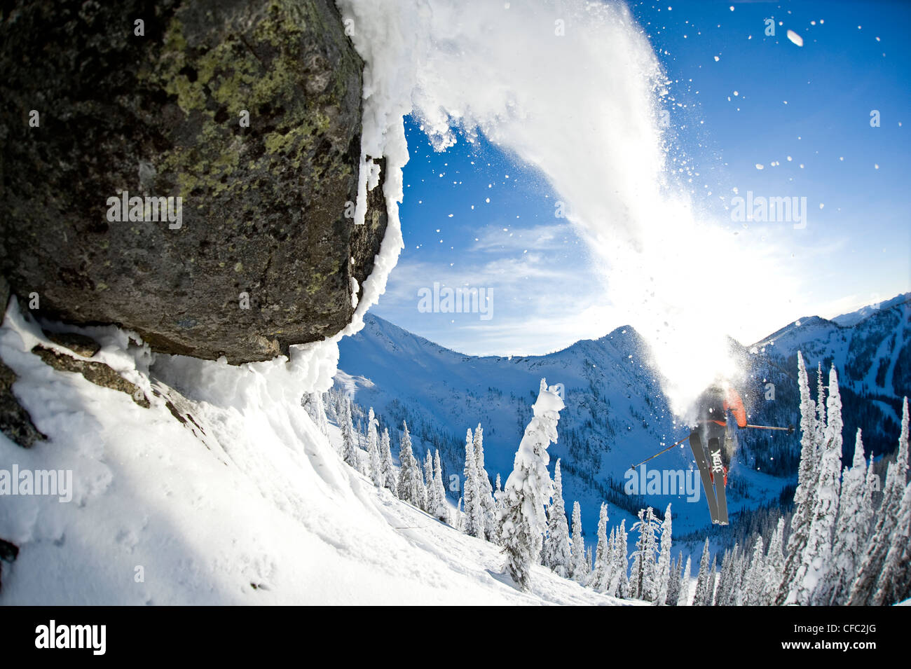 A male skier full of testosterone launches off a jump at Whitewater Winter Resort, Nelson, British Columbia - Stock Image