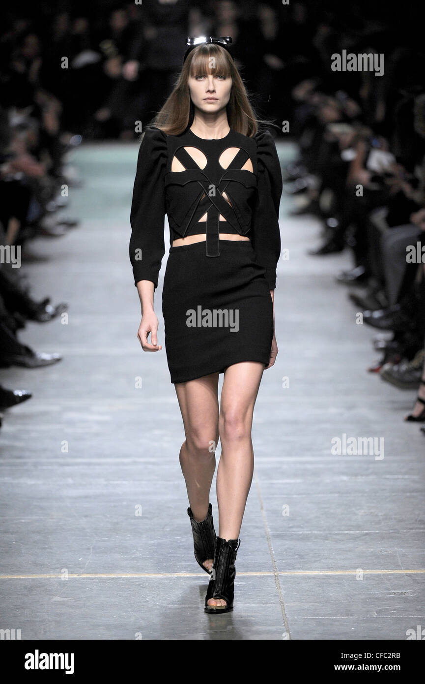 07456d1aedc7 Givenchy Paris Ready to Wear Spring Summer Model wearing a black dress  cropped puffed sleeves and