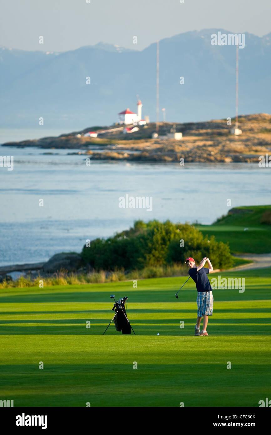 young golfer takes practice swing #3 fairway - Stock Image