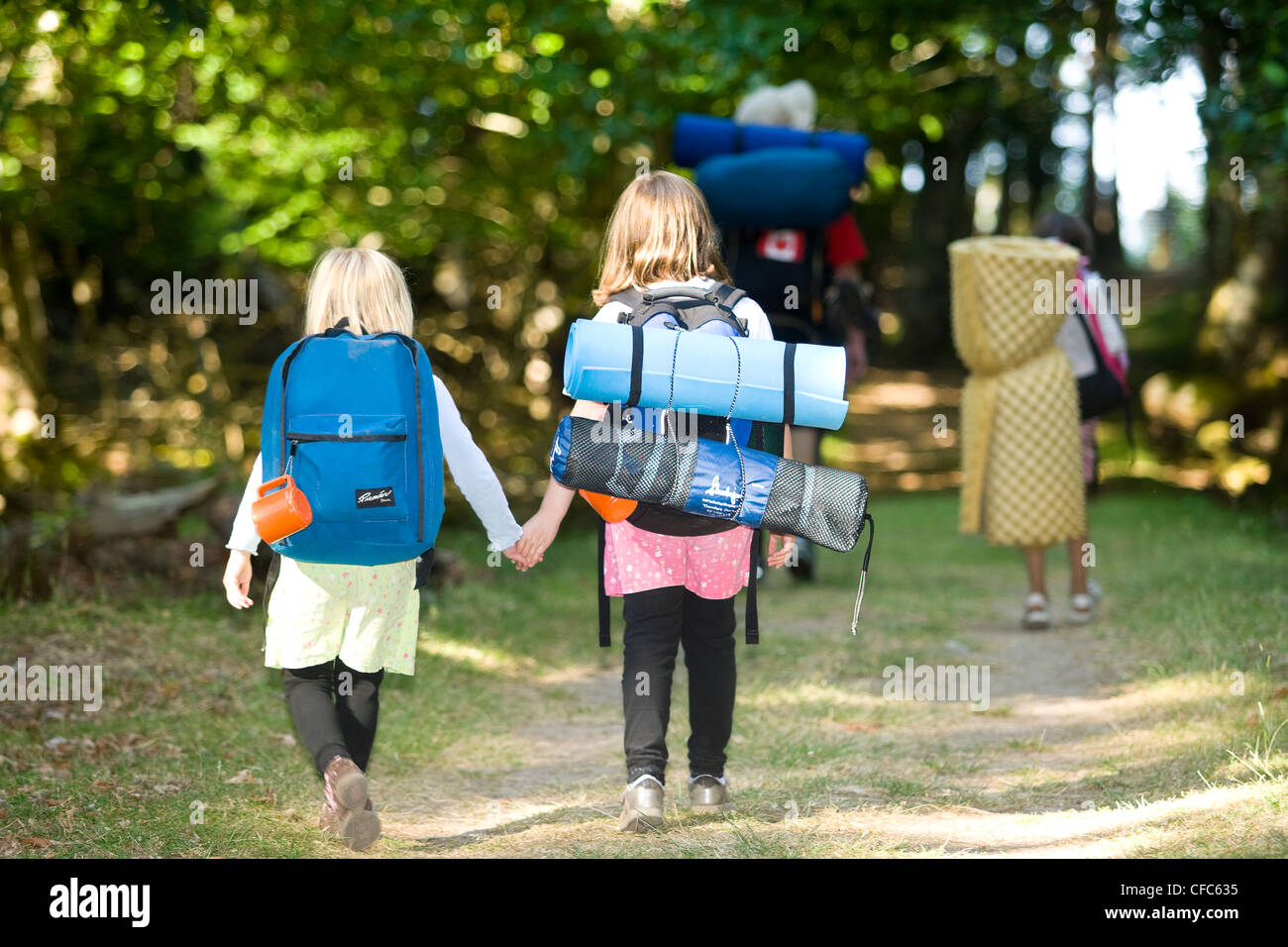 Two young campers at Sidney Island Marine Park, Sidney, Southern Vancouver Island, British Columbia, Canada. - Stock Image