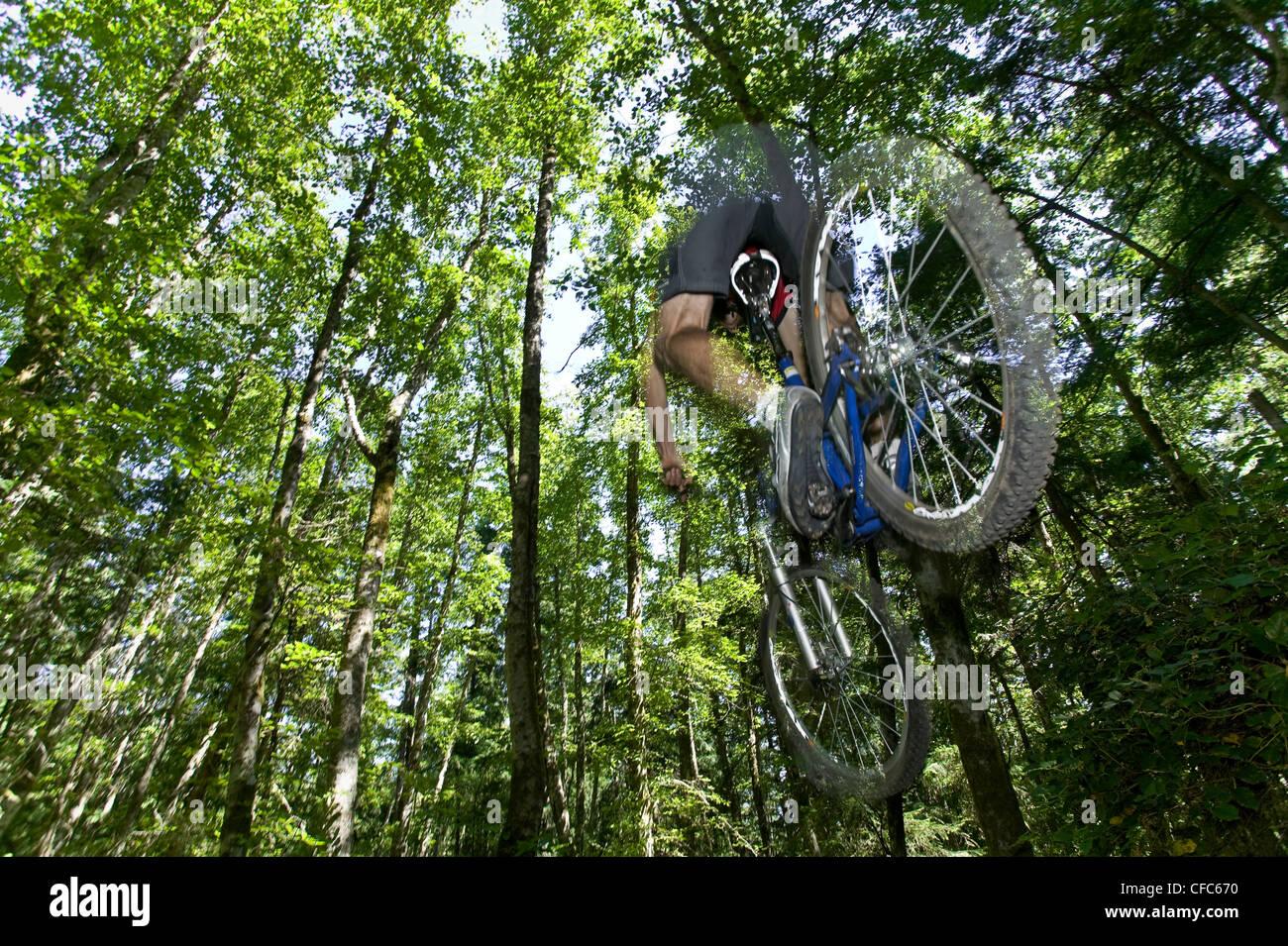 mountain biker photographed during jump - Stock Image