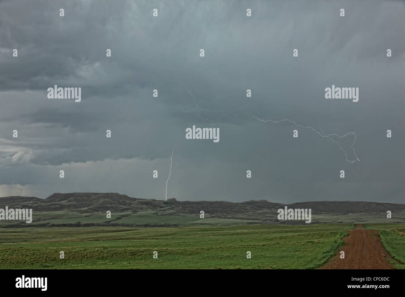 Lightning strikes over 70 Mile Butte, Grasslands National Park, Saskatchewan, Canada. - Stock Image