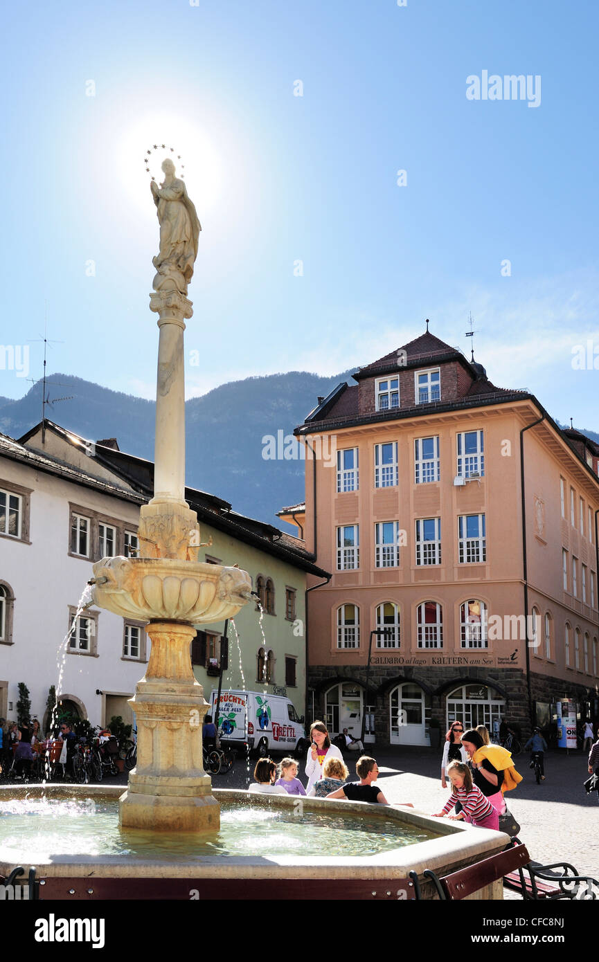 Group of persons in front of fountain of Kaltern, Kaltern, South Tyrol, Italy, Europe - Stock Image