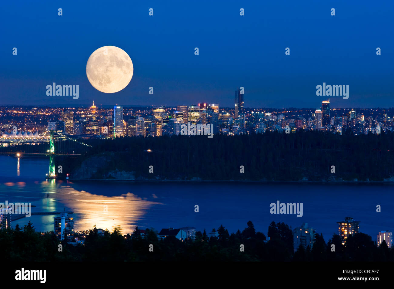 Moonrise over Vancouver. - Stock Image