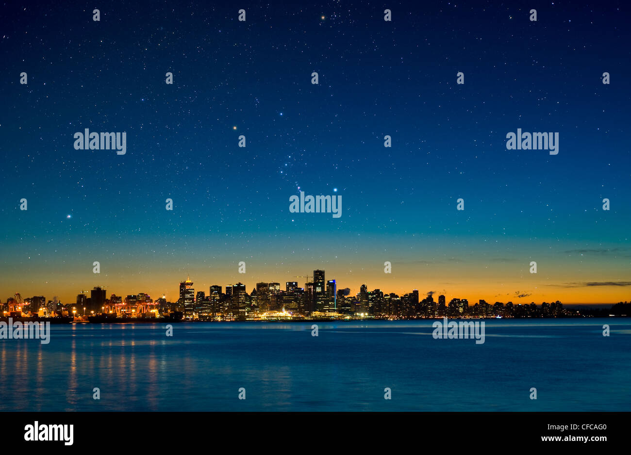 The constellation Orion setting over Vancouver skyline. - Stock Image