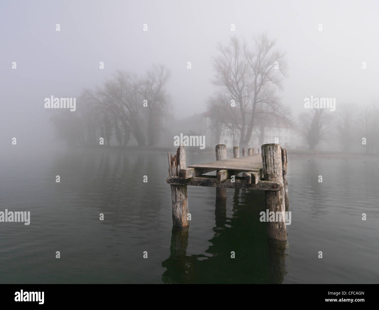 Old pier at Frauenchiemsee, Fraueninsel, Chiemgau, Bavaria, Germany Stock Photo