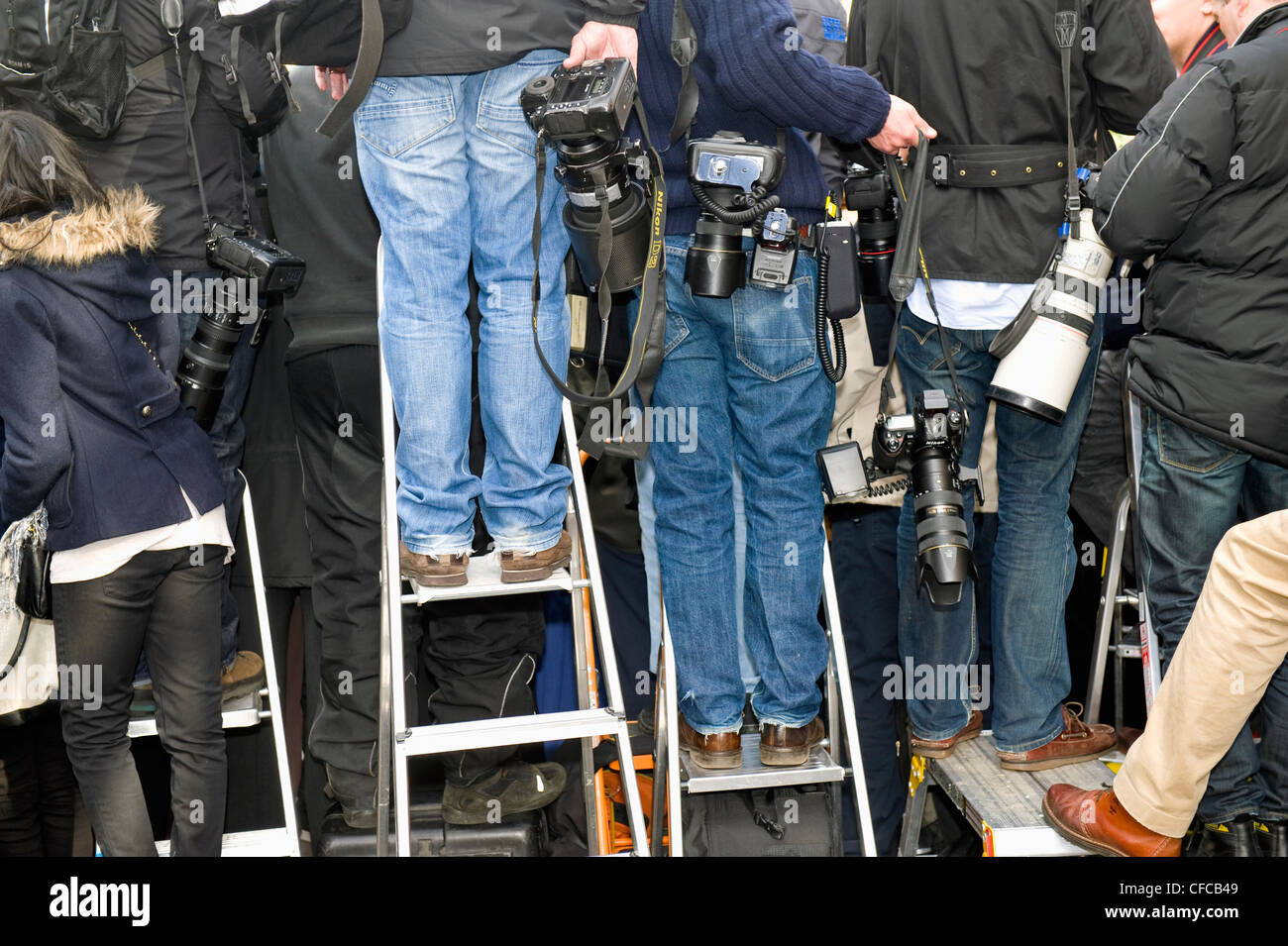 Professional photographers gain a height advantage over the crowd by using step-ladders. - Stock Image