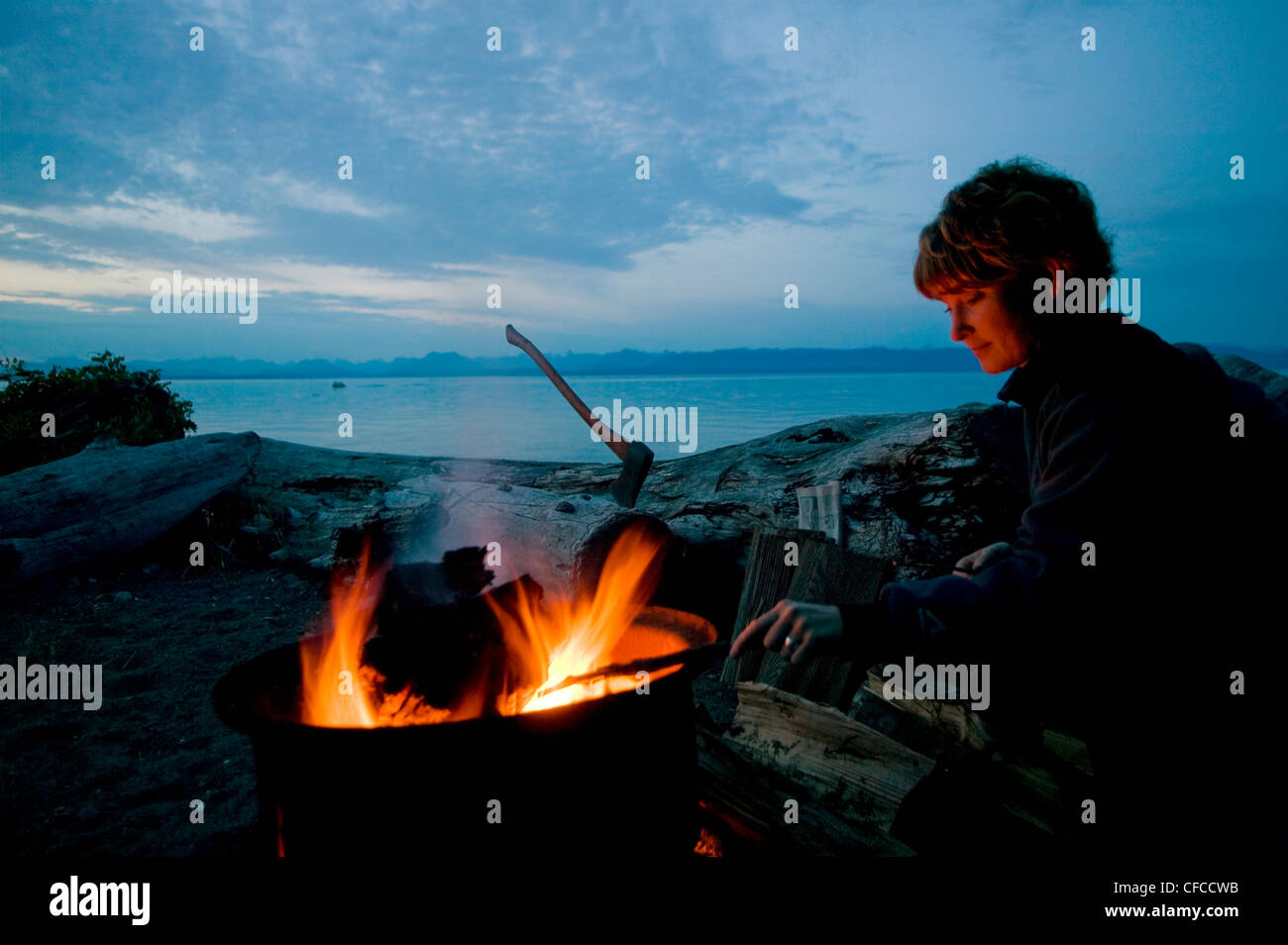 woman sidelit evening fire Kitty Coleman park Stock Photo