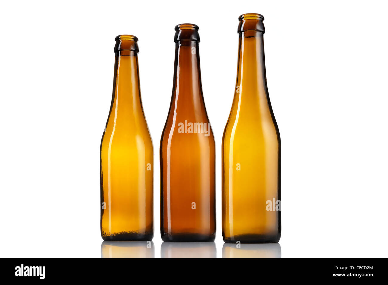 Three empty bottles of beer isolated on white background. Stock Photo