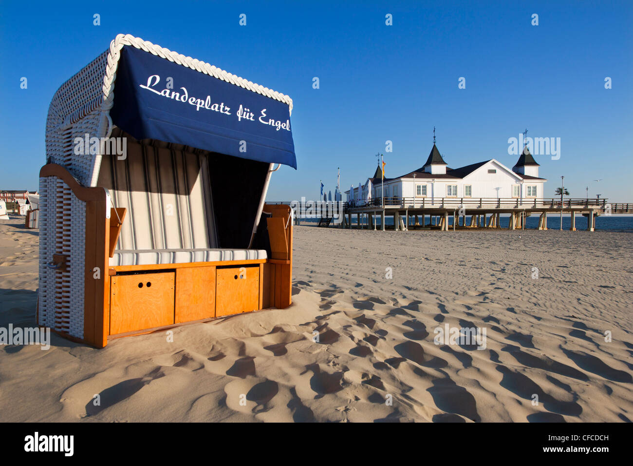 Beach chair and pier, Ahlbeck seaside resort, Usedom island, Baltic Sea, Mecklenburg-West Pomerania, Germany - Stock Image