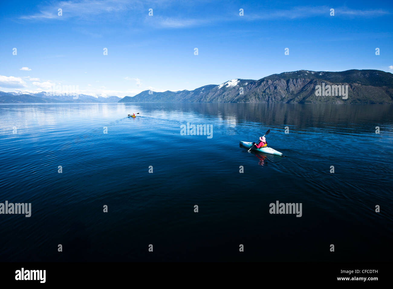 An happy adventurous retired couple kayaking on a huge calm lake in Idaho. - Stock Image