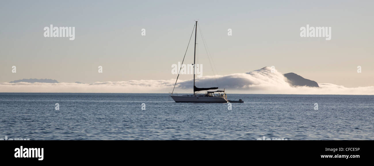Sailboat at anchor off Anacapa Island in the Channel Islands, California as the fog rolls in - Stock Image