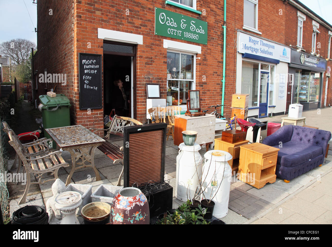 Odds and Sods antique shop with goods for sale on the pavement Watton Norfolk England UK Stock Photo
