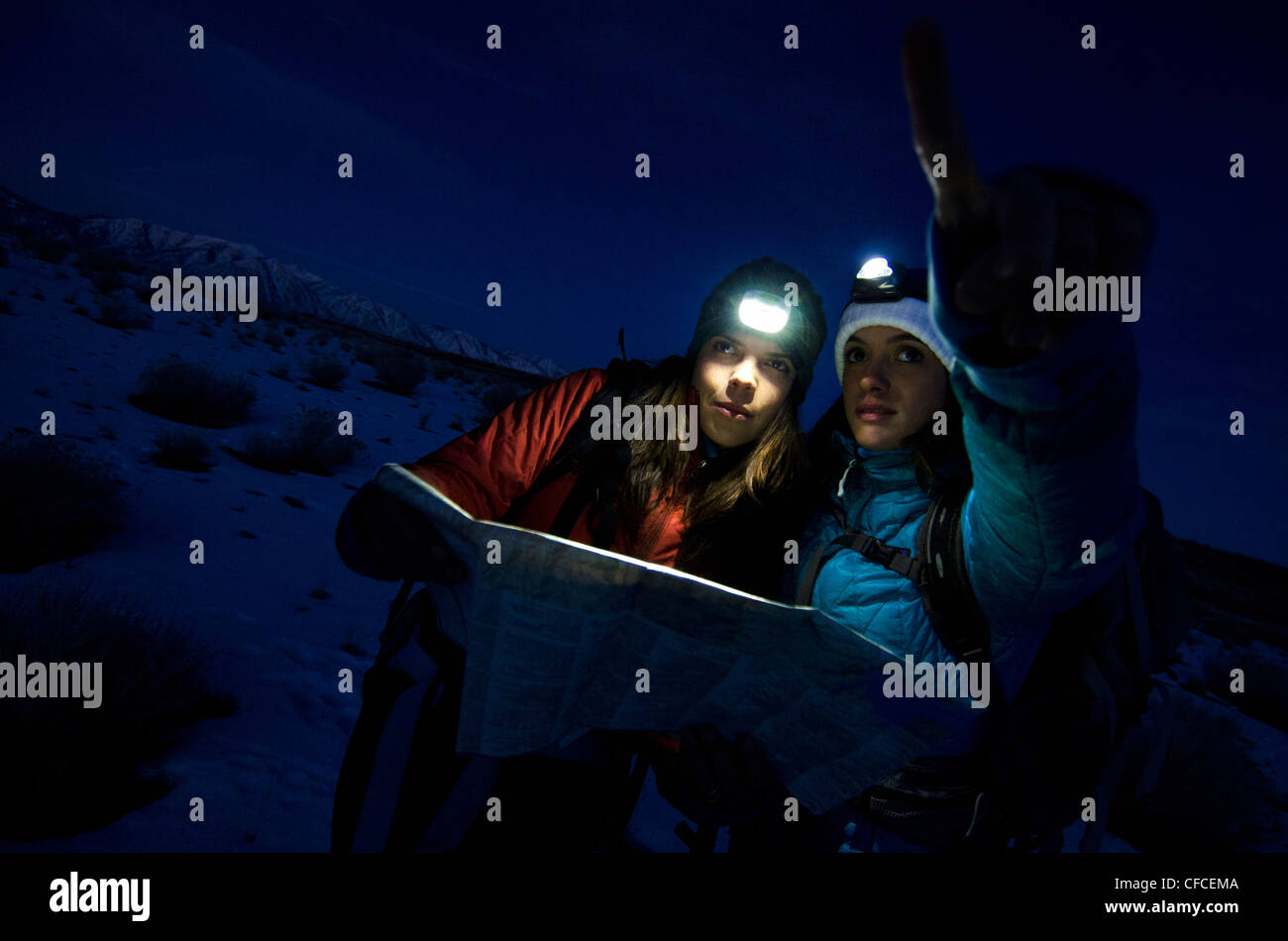 Two women discuss what route to take while hiking in the Sierra Foothills outside of Lake Tahoe, California. Stock Photo