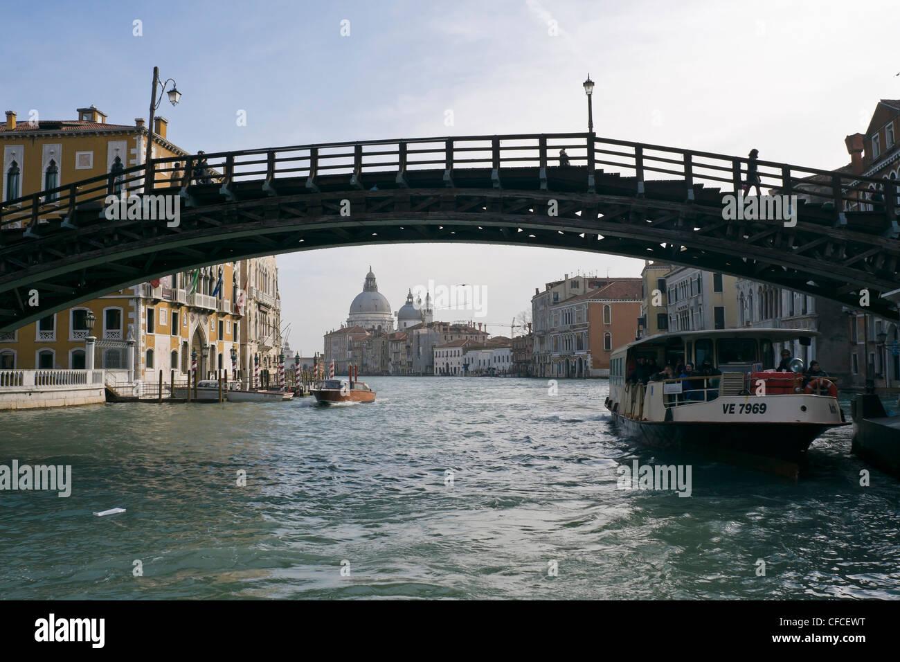 Academia bridge over Grand Canal, with Santa Maria della Salute church in the background - Venice, Venezia, Italy, Stock Photo