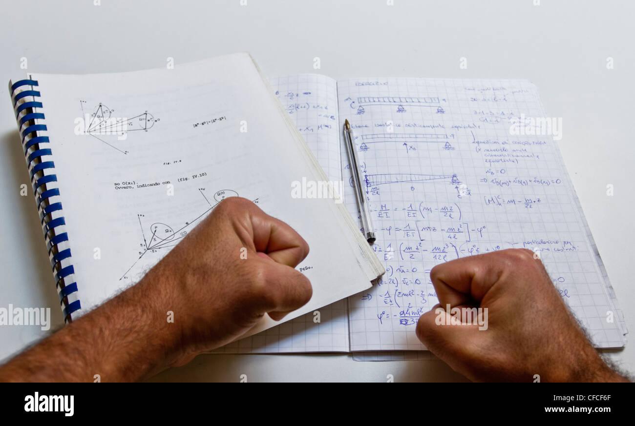 Studying Physics, note. - Stock Image