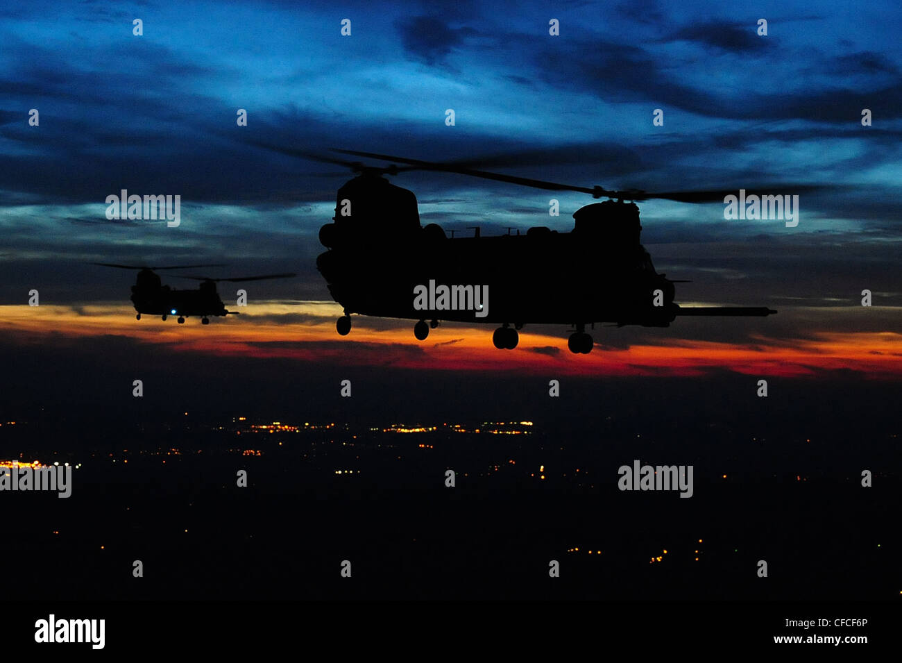 U.S. Army CH-47 Chinook helicopters continue a mission after being aerially refueled during Emerald Warrior, Duke Stock Photo