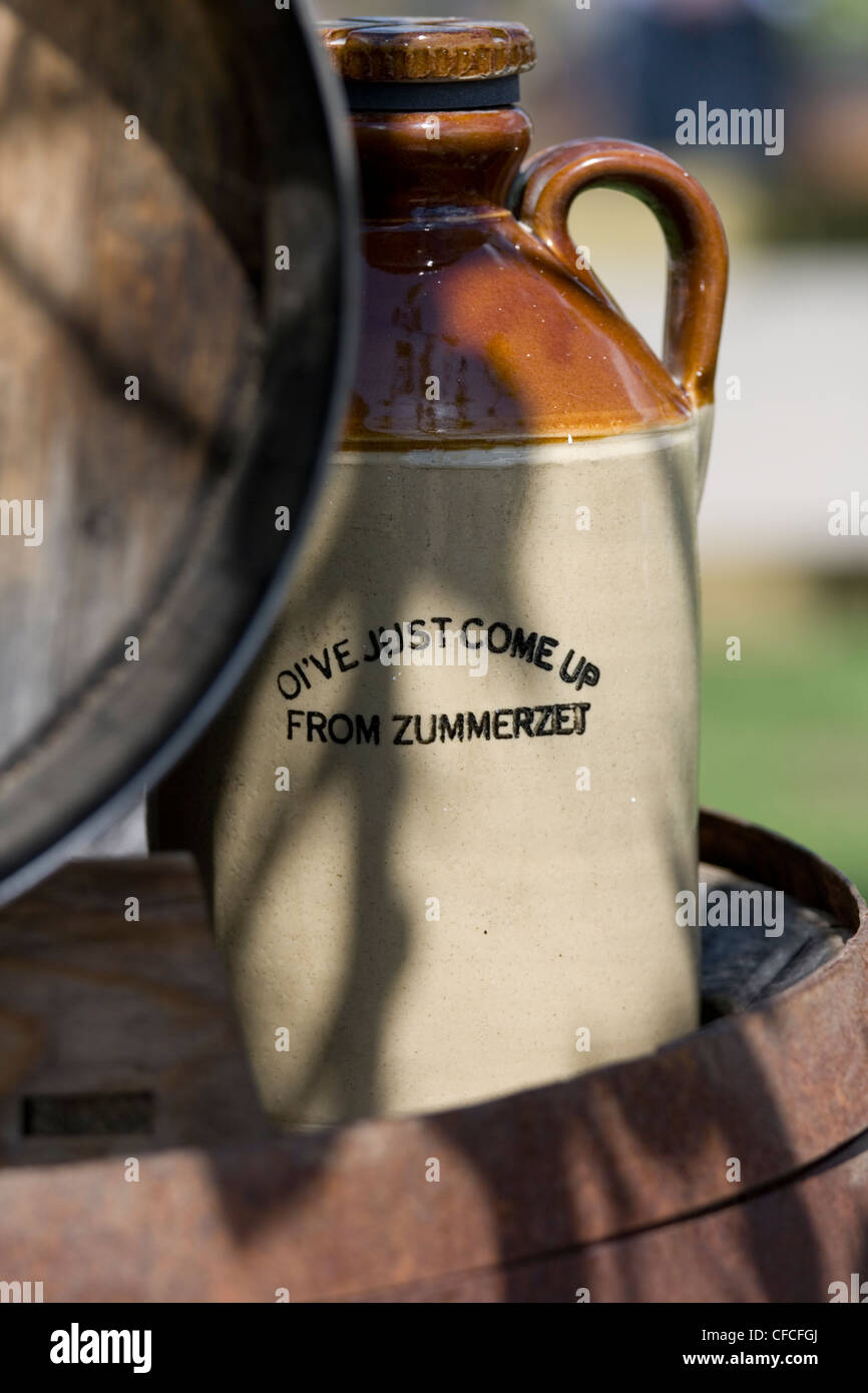 Cider flagon next to barrel Stock Photo