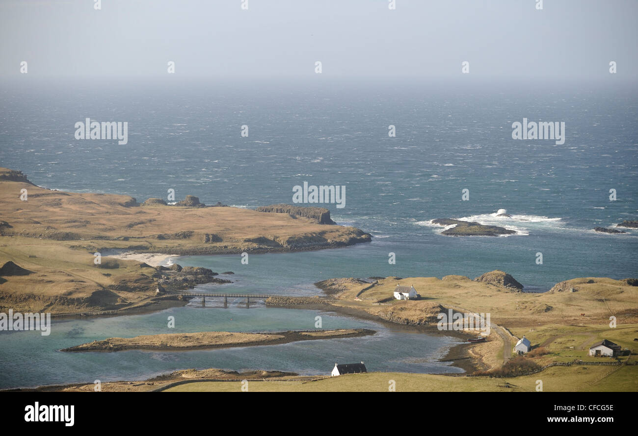 A view from Compass Hill across to Sanday The island of Canna in the Inner Hebrides off the west coast of Scotland. - Stock Image