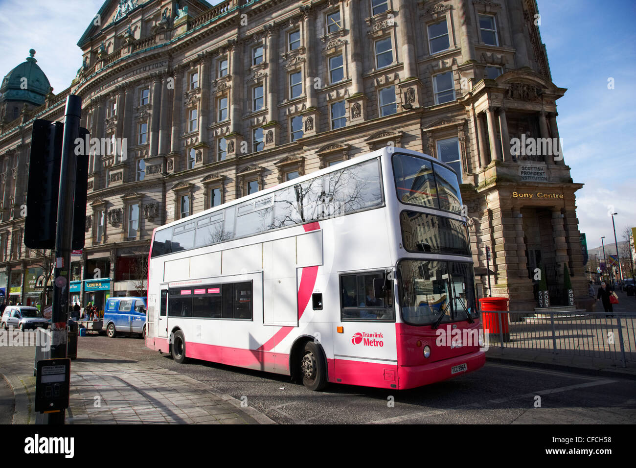 belfast metro citybus double deck bus on donegal square west in front of the scottish provident institution building - Stock Image