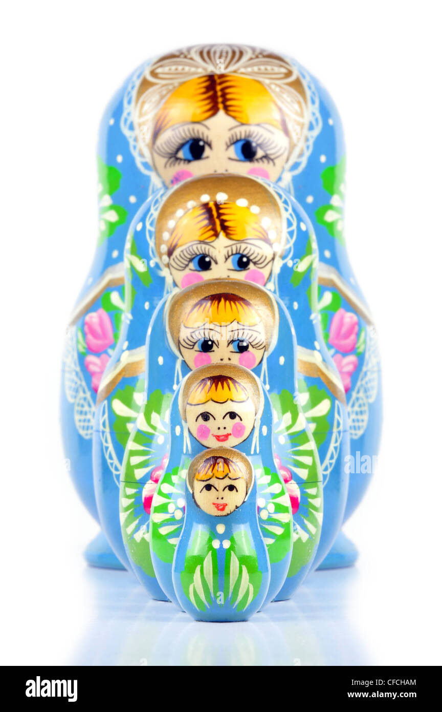 Matrioska Russian Doll, hand-painted, isolated in white background, shadow underneath - Stock Image