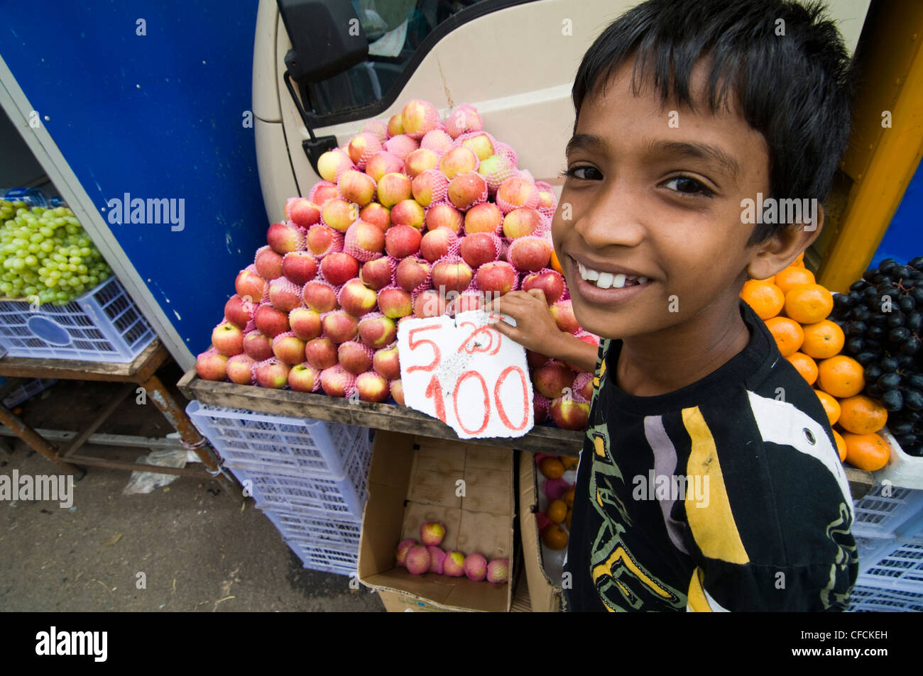 A boy selling fruit in the market in Colombo. - Stock Image