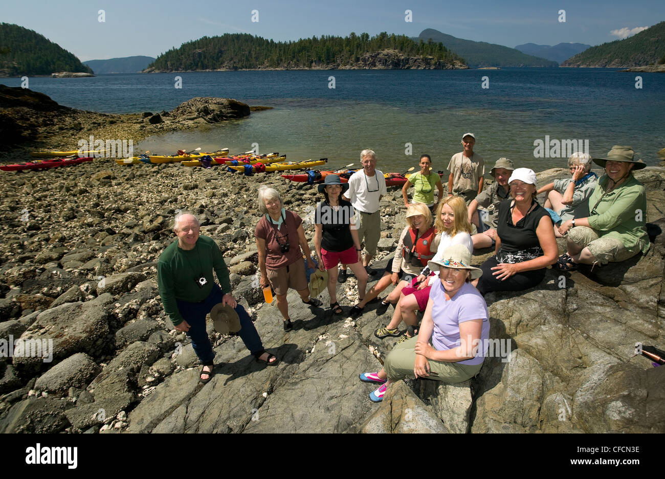 Paddlers Misty Isle's kayak business pose group - Stock Image