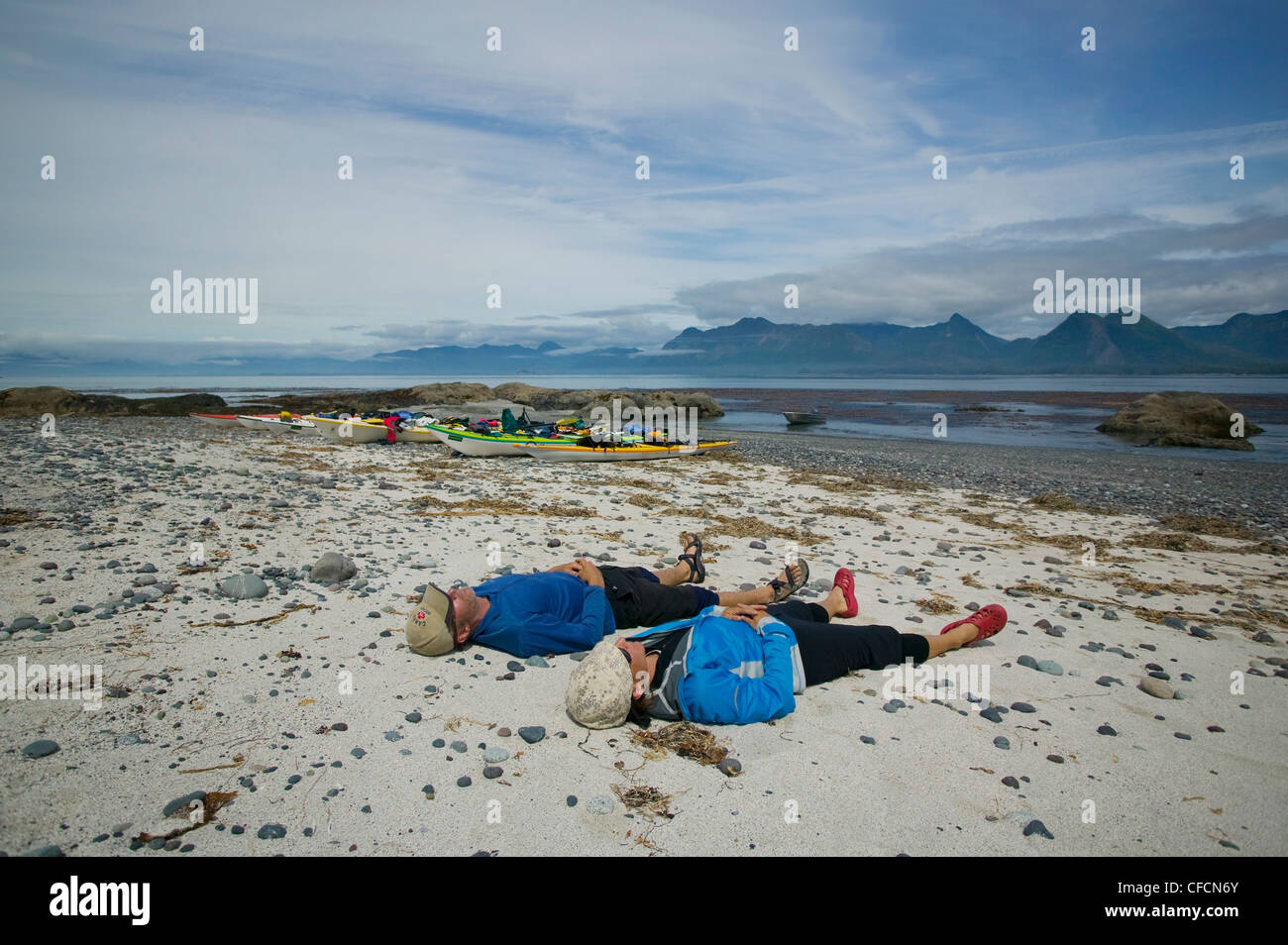 Two paddlers relax after morning paddle Lookout - Stock Image