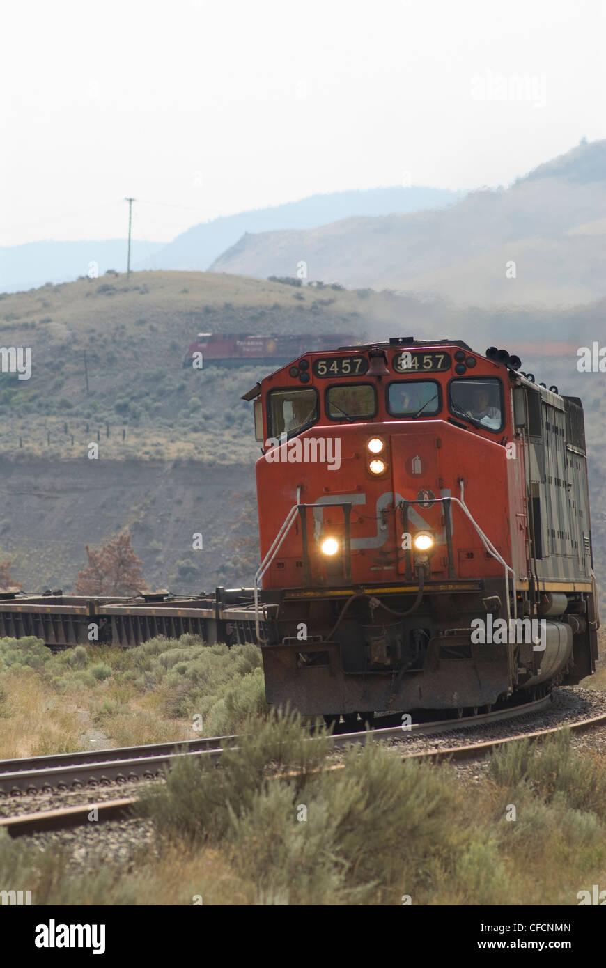 CN freight train near Ashcroft BC passes Juniper - Stock Image