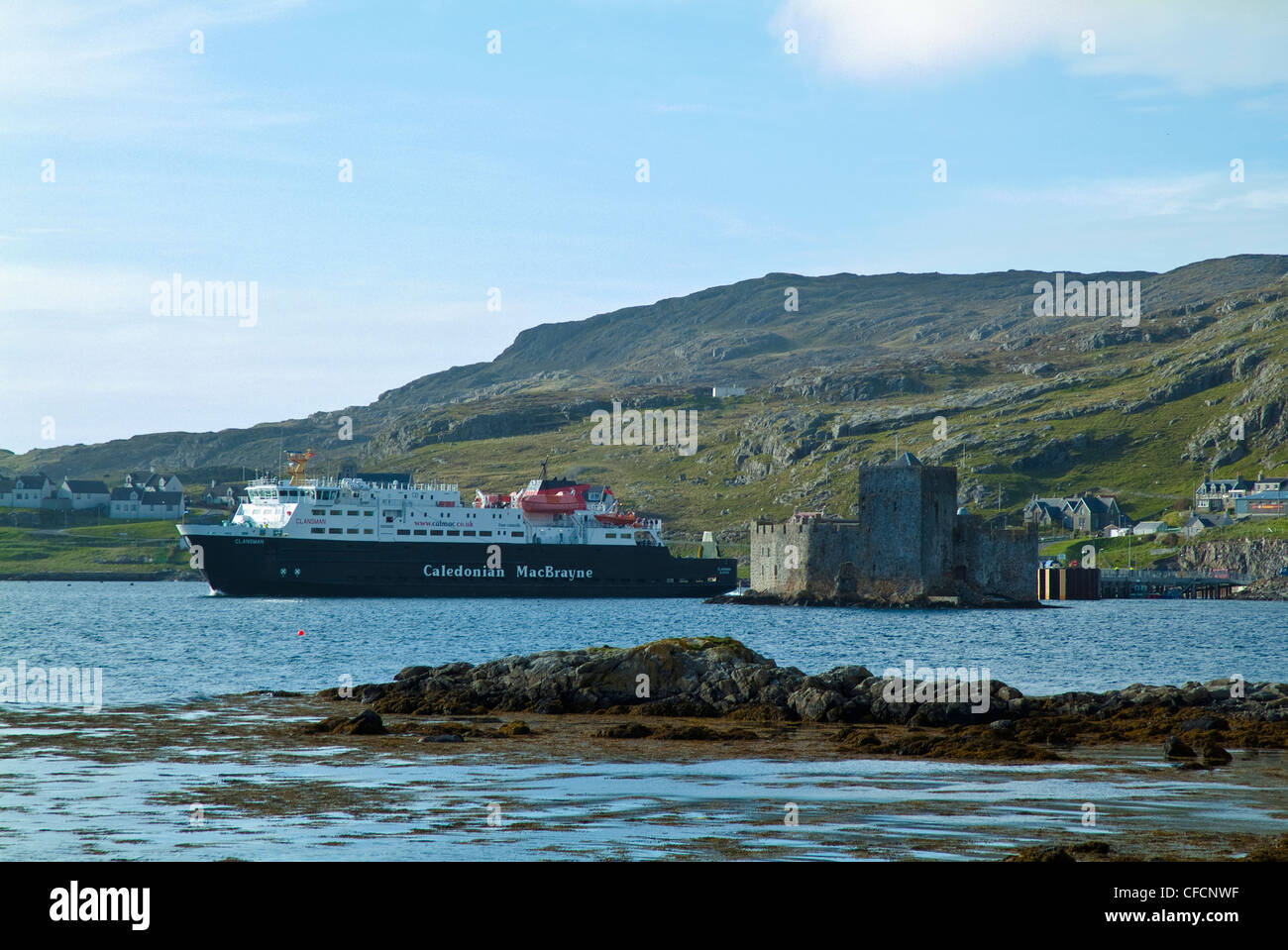 Ferry 'Clansman' and Kisimul Castle, Castlebay, Isle of Barra, Western Isles, Scotland. Stock Photo