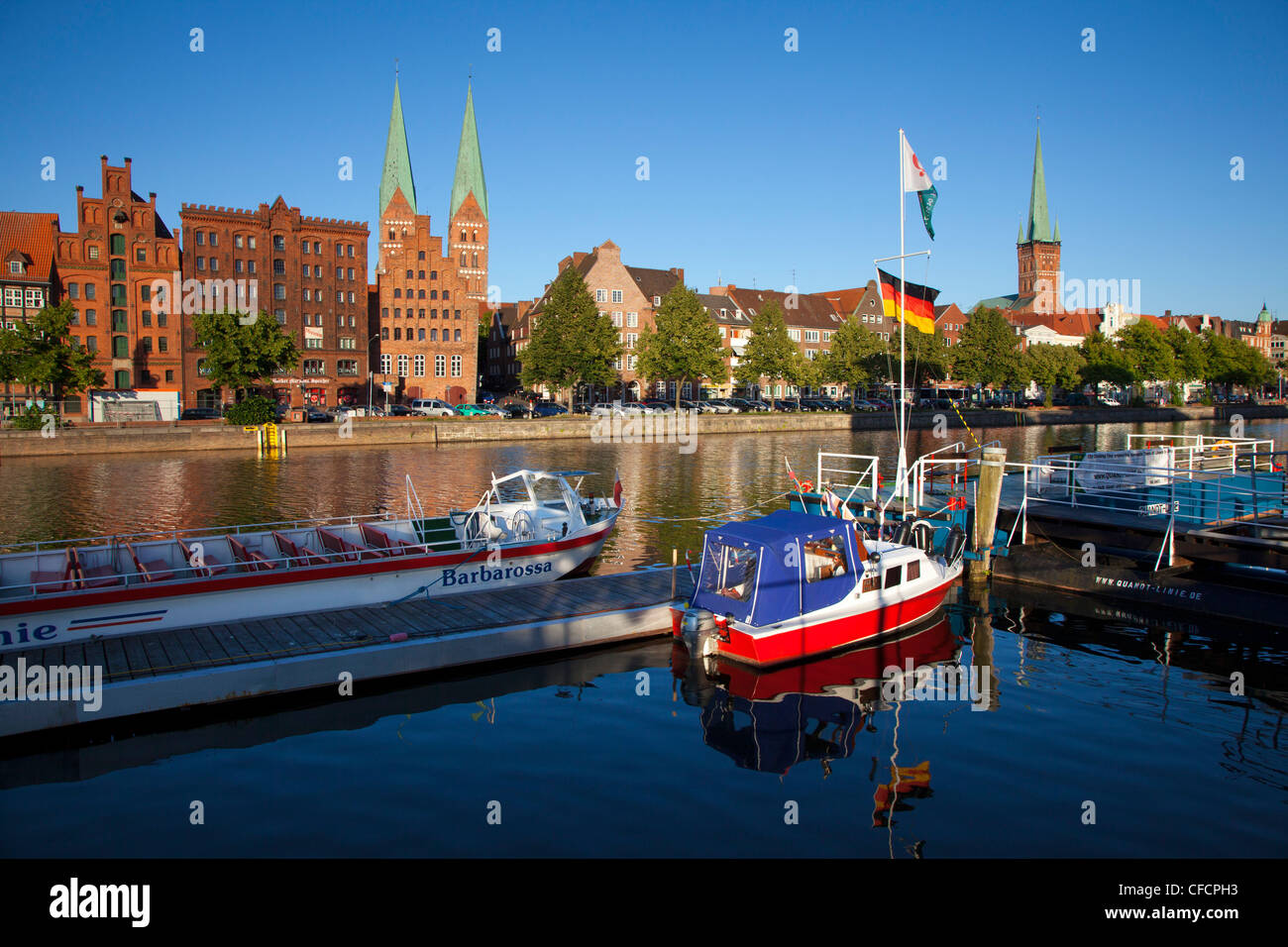 Old storehouses at Holsten harbour, St Mary´s church and church of St Petri, Hanseatic city of Luebeck, Baltic - Stock Image