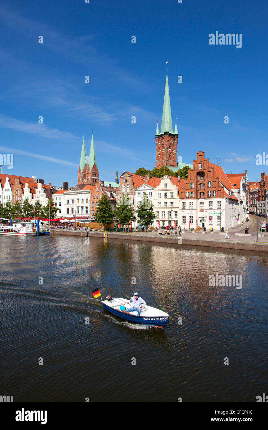 View over the Trave river to the old town of Luebeck, with St Mary´s church and church of St Petri, Hanseatic - Stock Image