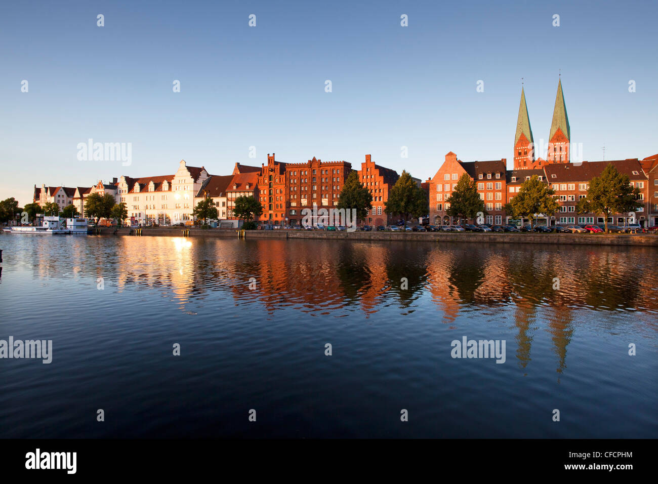 Old storehouses at Holsten harbour, St Mary´s church, Hanseatic city of Luebeck, Baltic Sea, Schleswig-Holstein, - Stock Image