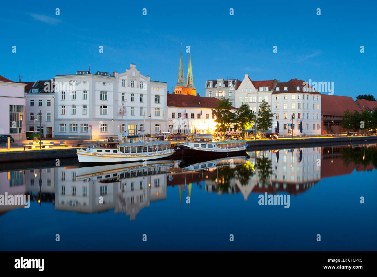 View over the Trave river to the old town of Luebeck with Luebeck cathedral, Hanseatic city of Luebeck, Baltic Sea, - Stock Image