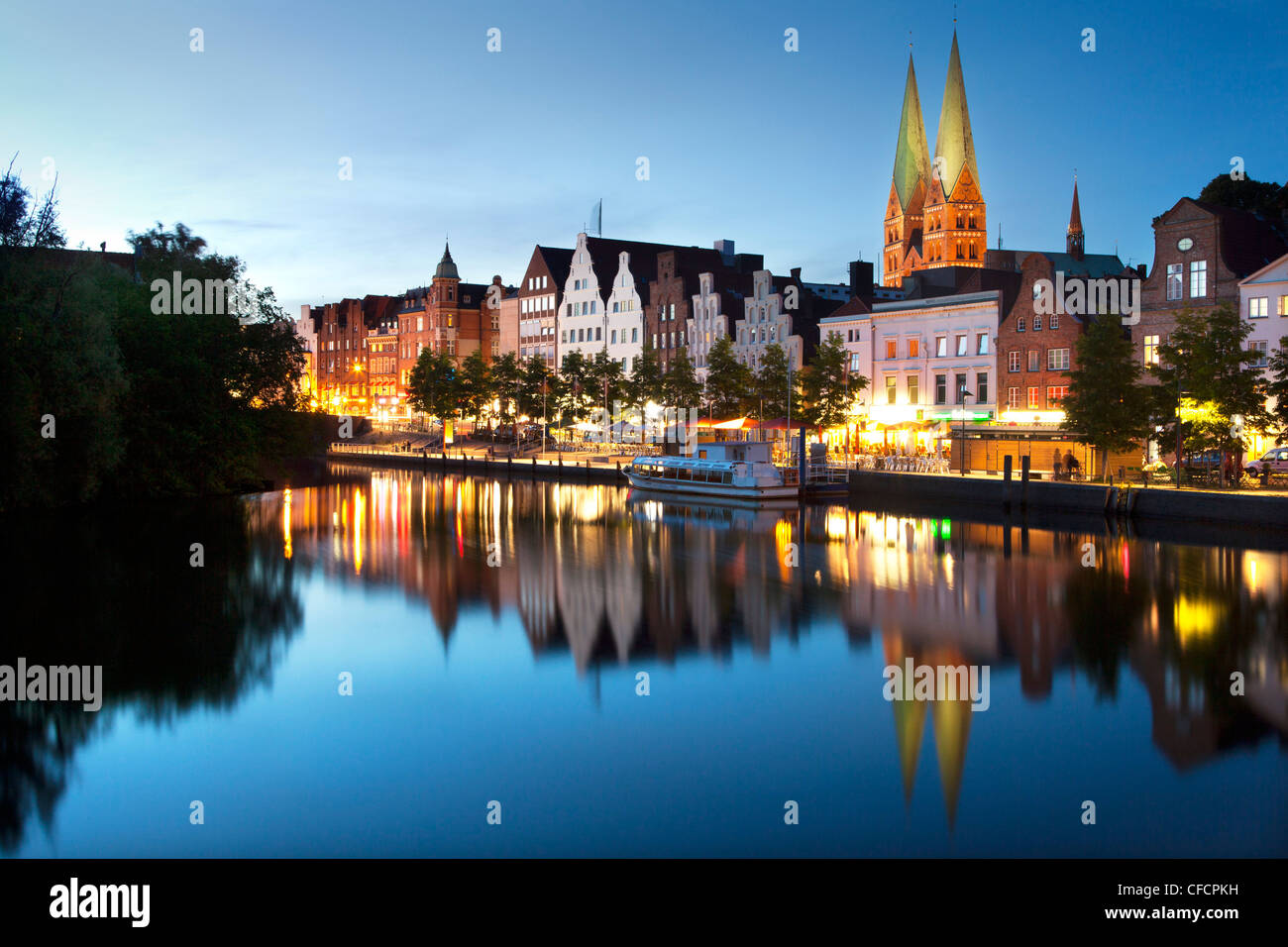 View over the Trave river to the old town of Luebeck with St Mary´s church, Hanseatic city of Luebeck, Baltic - Stock Image
