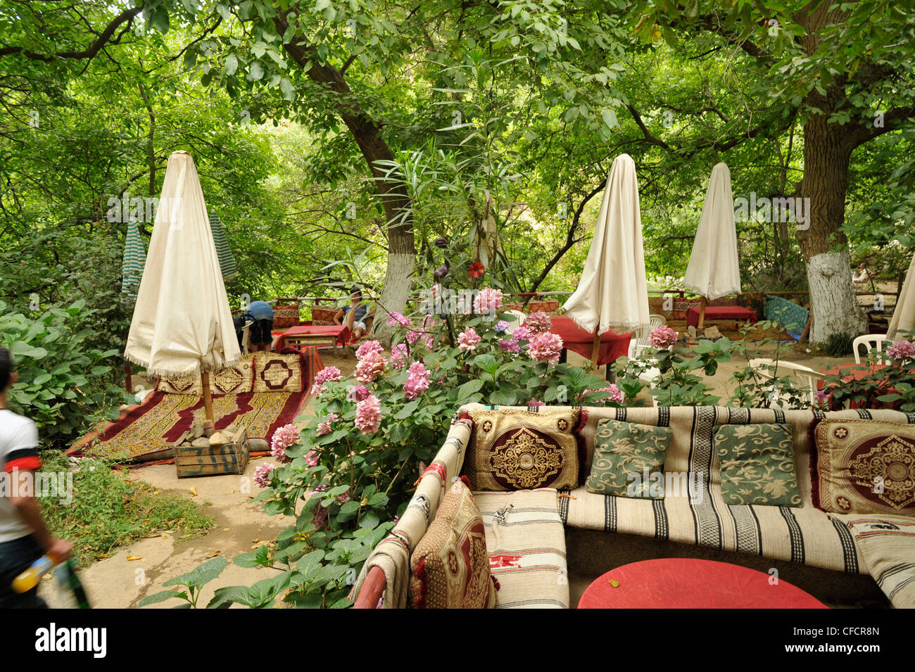 Waterfall at Setti Fatma, open air teahouse with plushy cushions at High Atlas, Morocco, Africa Stock Photo