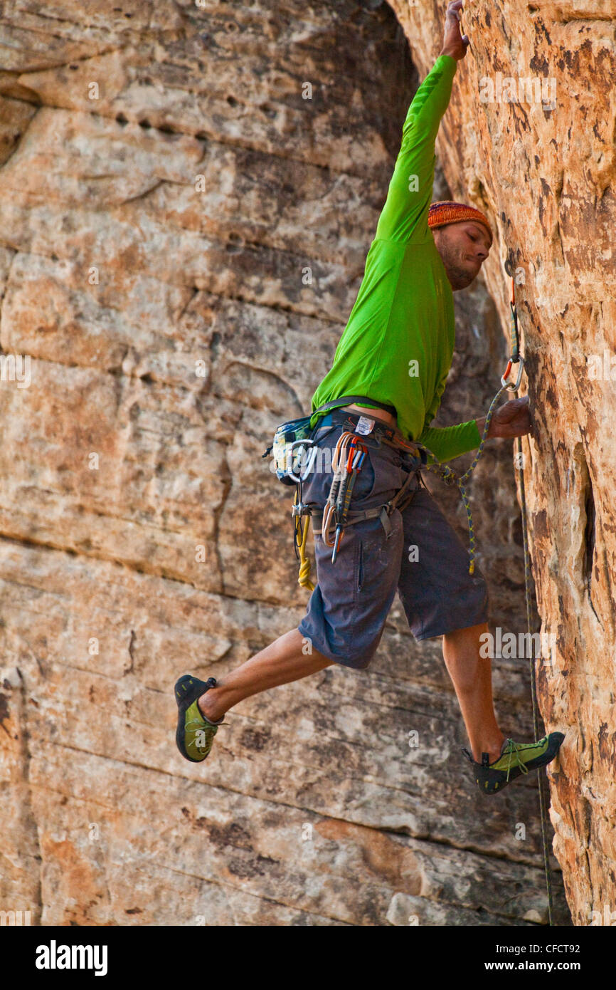 A male climber sport climbing in Red Rocks, Las Vegas, Nevada, United States of America - Stock Image