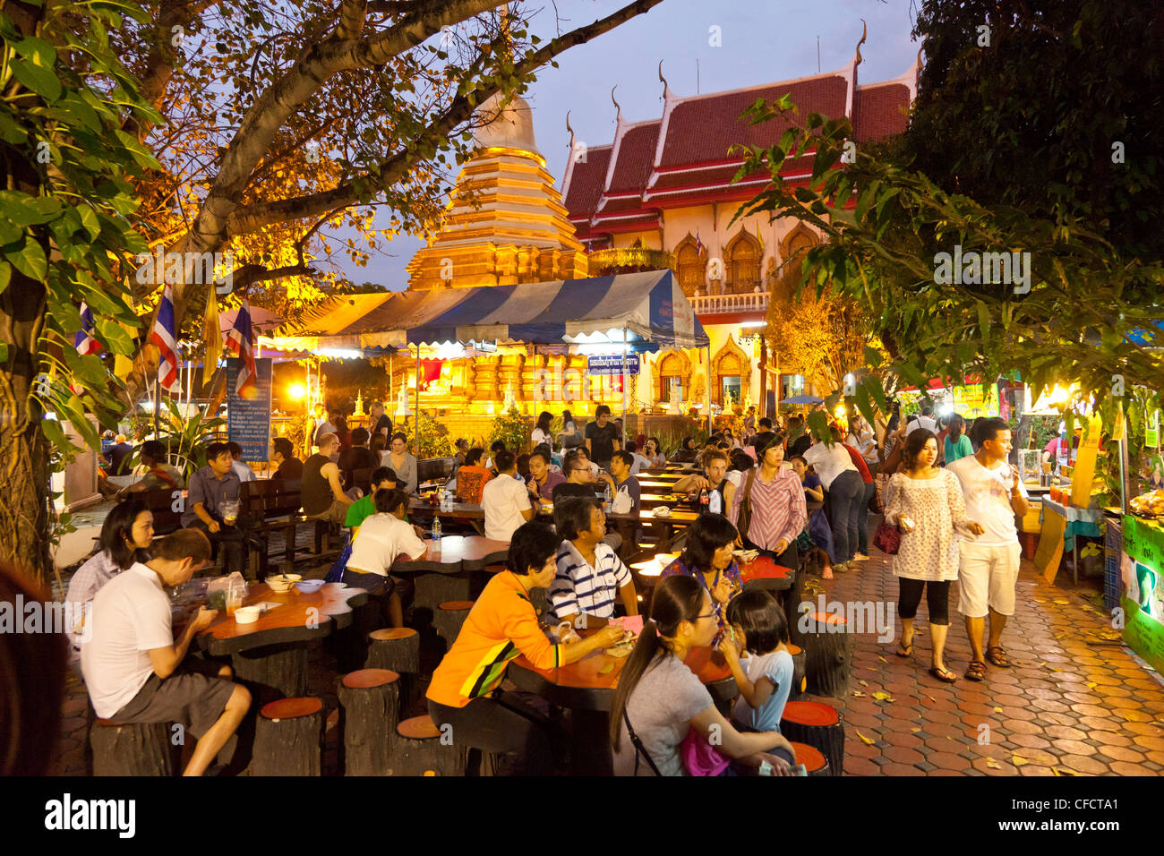 People at tables of restaurants at the night market, Chiang Mai, Thailand, Asia - Stock Image