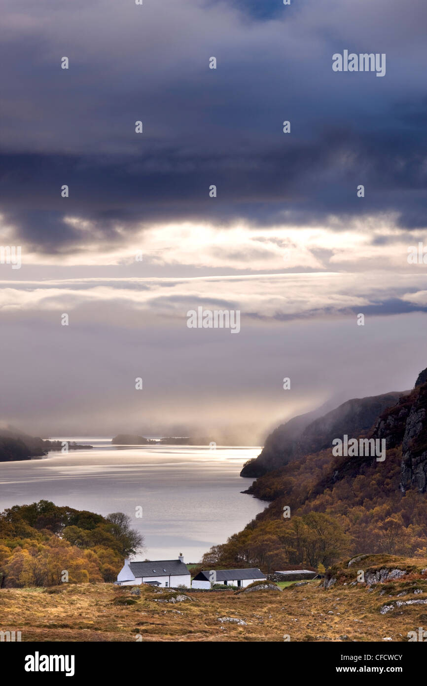 Early morning mist hanging over Loch Maree, Wester Ross, Highlands, Scotland, UK - Stock Image
