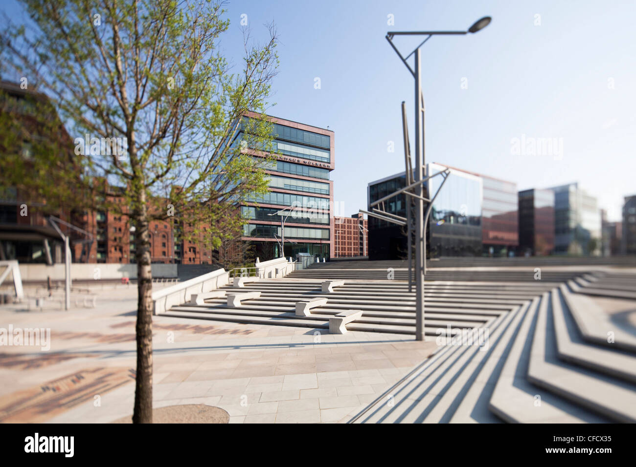 Office building, staircases in foreground, HafenCity, Hamburg, Germany - Stock Image