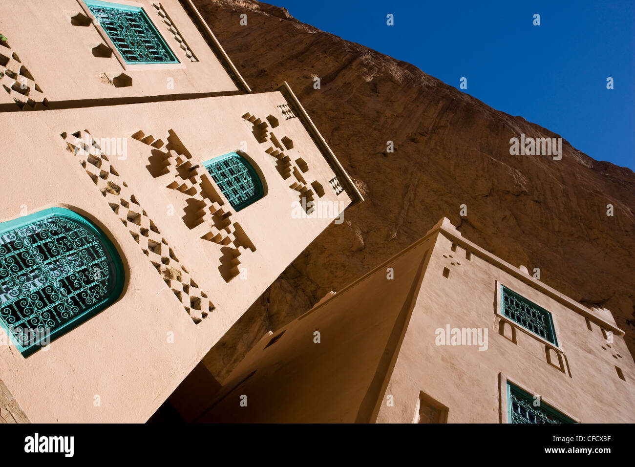 Walls of the Hotel Jasmina against the towering walls of the Todra Gorge near Tinerhir, Morocco, North Africa, Africa - Stock Image