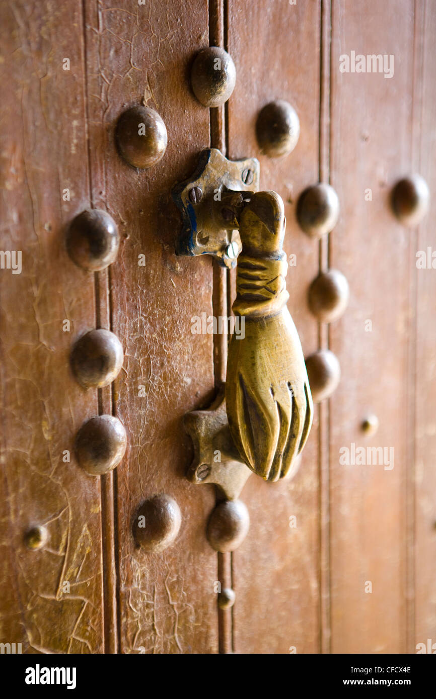 Brass Hand of Fatima door knocker, a popular symbol in Southern Morocco, Merzouga, Morocco, North Africa, Africa - Stock Image