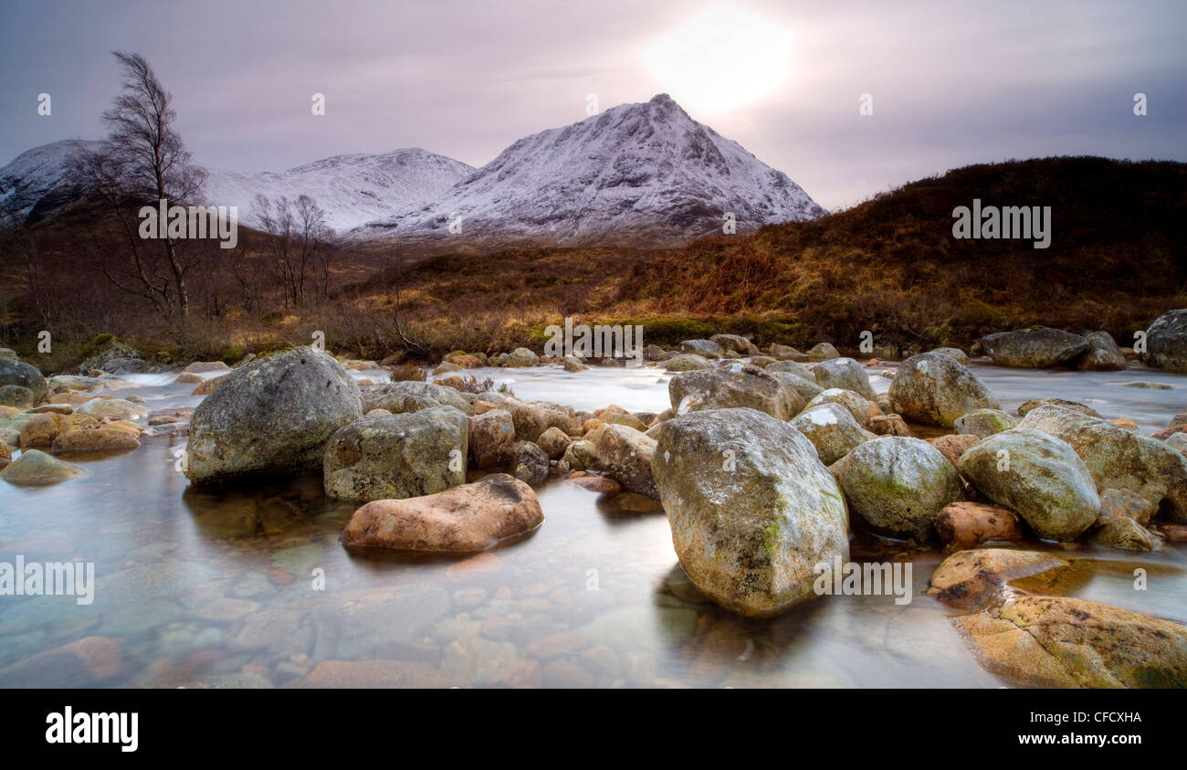 River Coupall, just,the Coupall Falls, looking towards snow-covered mountains, Glen Etive, Highland, Scotland, UK - Stock Image