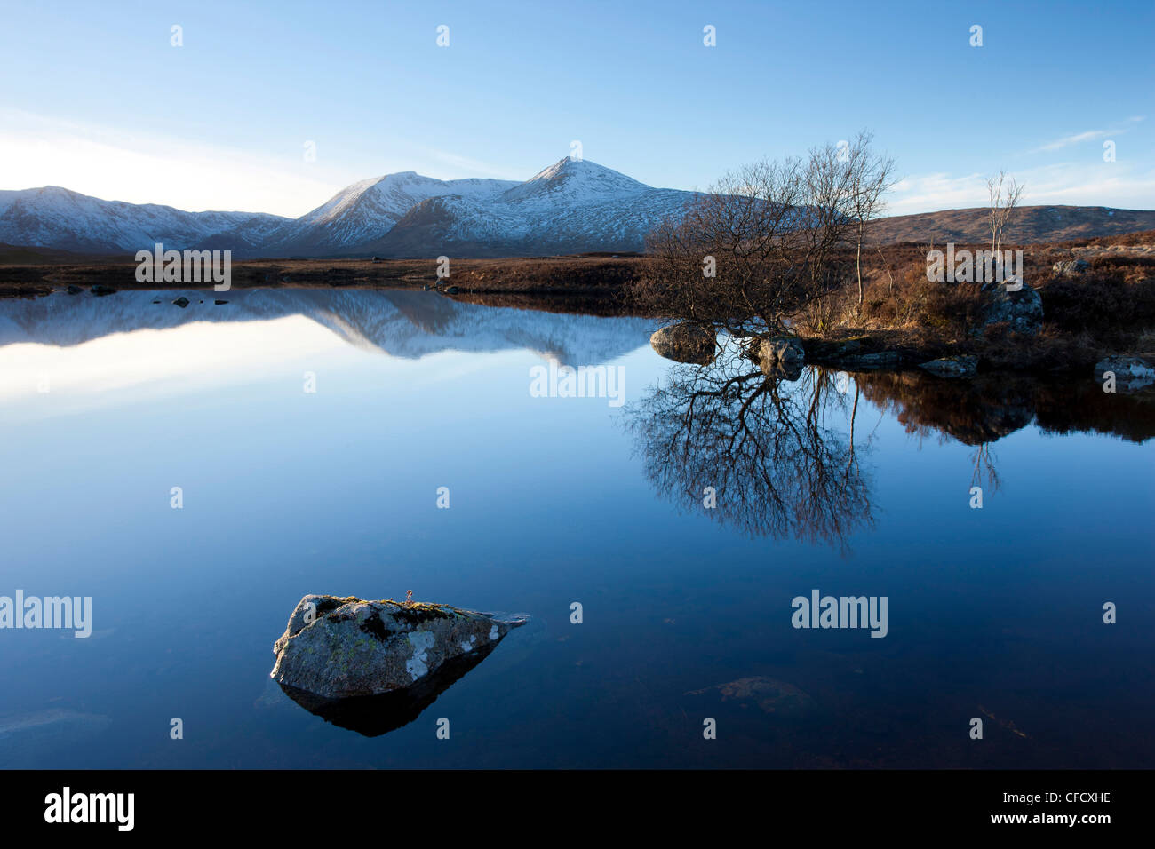 Black Mount Hills and their reflection in the flat calm Lochain na h'Achlaise, Rannoch Moor, Highland, Scotland, - Stock Image