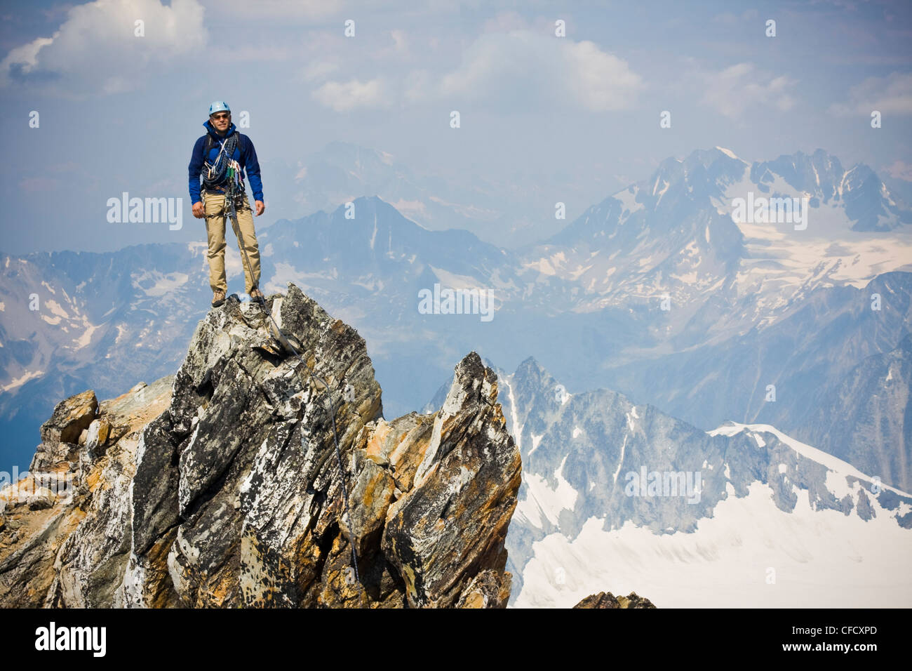A young man mountain climbing the classic north west ridge of Mt. Sir Donald, Glacier National Park, British Columbia, - Stock Image