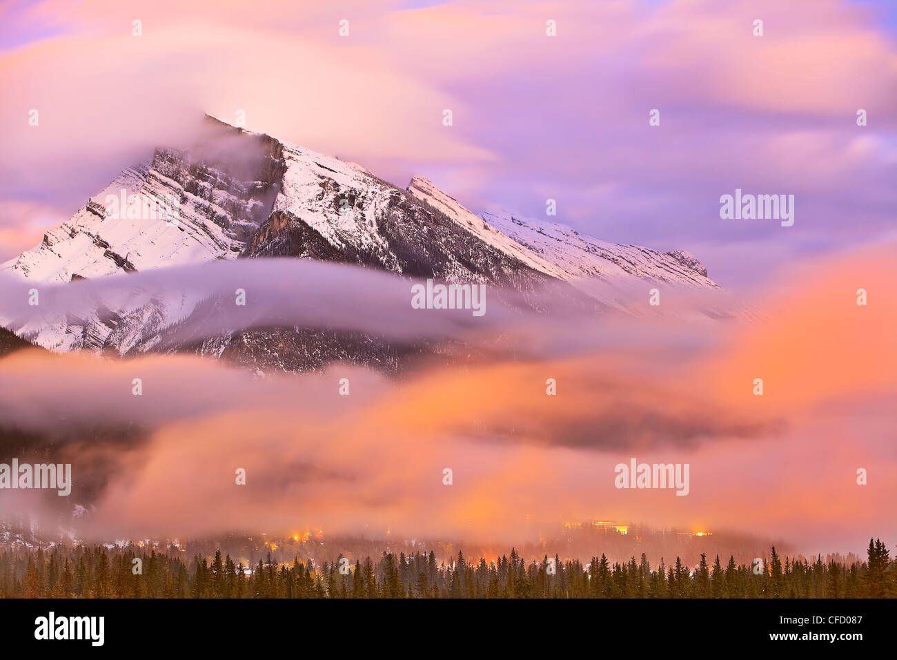 Mount Rundle, Banff townsite at dusk and dramatic clouds. Banff National Park, Alberta, Canada. - Stock Image