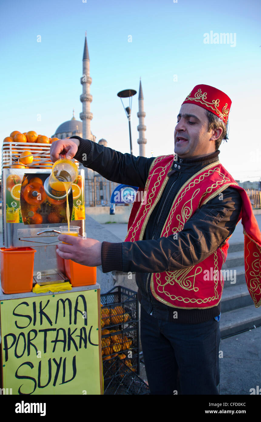 Ornage juive vendor on the Golden Horn by the Galata Bridge, located in the Eminönü district of Istanbul, - Stock Image