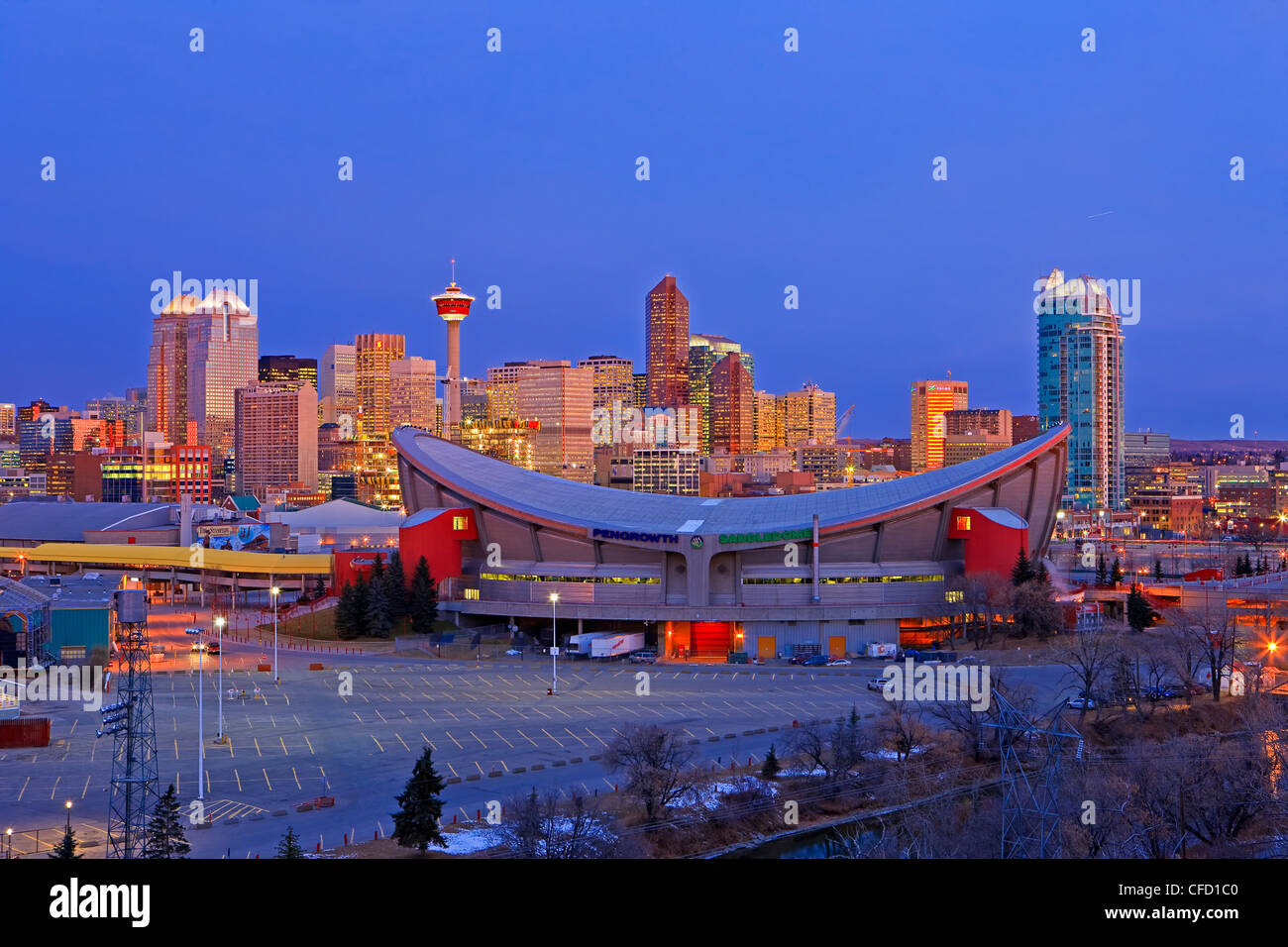 The Saddledome With High Rise Buildings And The Calgary